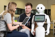 Two researcher with Pepper robot